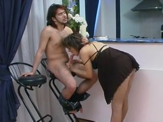 Mom in negligee sucks son's cock and gets owned from behind