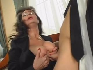 Busty MILF sucks cock and gives tittyfucking