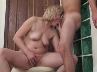 Licentious mature woman forcibly sucks young dude off