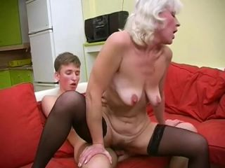 Flabby woman in black stockings is grateful to son for sex