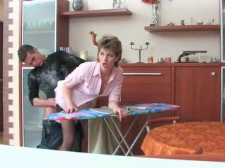 Twisted mom in black stockings is banged on ironing board