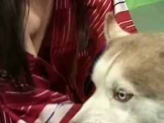 Asian Pets Her Dog With Her Tits Out